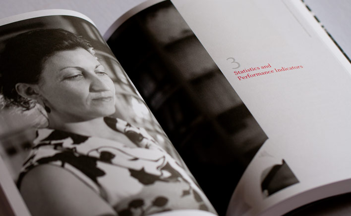 A section start from the CDPP Annual Report uses a large photograph across the spread and an elegant serif typeface with white space to allow the pages to breath.