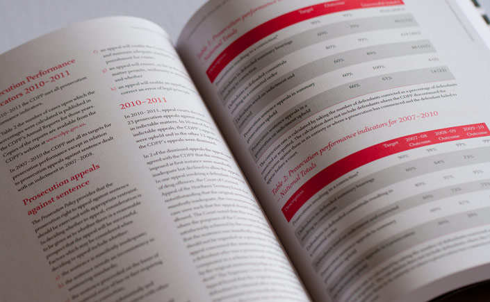 A double page spread with long text and tables. Complying with reporting guidelines, this annual report is printed in two colours - black and a Pantone red - with no bleed.